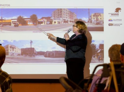 photo of woman pointing at picture screen