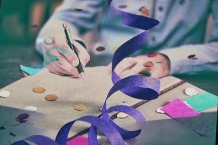 photo of gift wrapping with purple ribbon