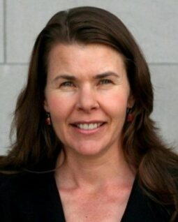 photo of woman with dark hair smiling